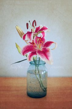 mason jar with stargazer lilies; too plain, not sure if lilies would be too big for mason jar if there were more flowers