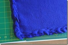 Tutorial to easily finish fleece blanket edges without sewing. Uses a crochet hook to pull strips through