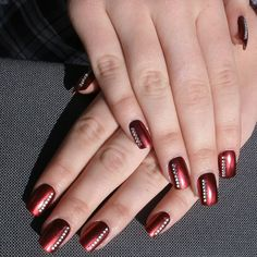 The shiny gems accentuate the red hue nails