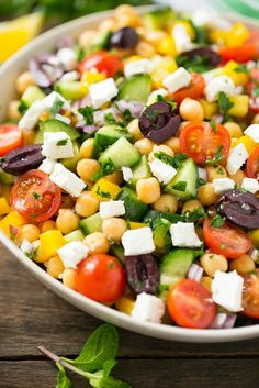 This recipe for greek chopped salad is a variety of fresh vegetables with chickpeas, creamy feta cheese and olives, all tossed in a greek lemon and herb vinaigrette.