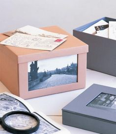 Use old shoe boxes for pictures.  Cover in brown/colored paper and add a picture of the trip/theme that is inside