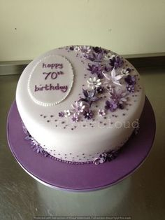 Delicate Lilac Purple And White Flowers On This 70th Birthday Cake