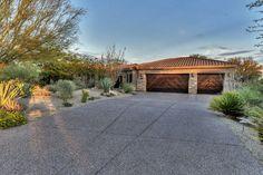 Custom garage doors and stone exterior.  Scottsdale Arizona