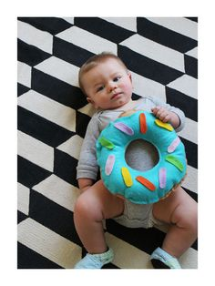 "8 Adorable Babies Dressed As Food For Halloween- Doughnut Baby- Your toddler is guaranteed to be the cutest on the block dressed as this sweet treat. Get more ""edible"" costume ideas at redbookmag.com."