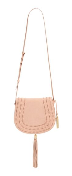 Obsessing over this cute leather crossbody in pale pink! This chic saddle bag is perfect for every day.