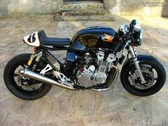 Honda-cb-750-cafe-racer_1[6] by Goodhal Garage, via Flickr