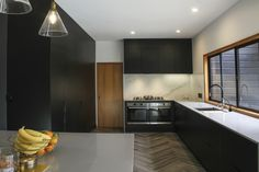 A Black on Black Hardware and Cabinetry Solution