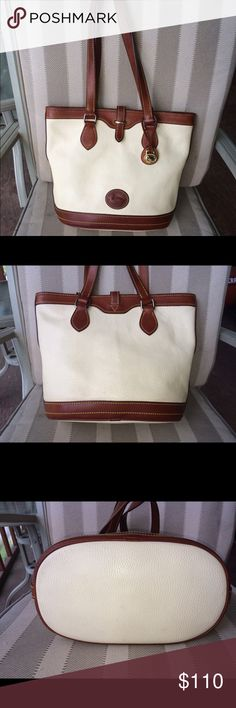 """All Weather Leather 2 Bucket Bag Ivory AWL2 with tan trim 11 x 10 1/4 x 6 with 10"""" strap drop. Inside has 1 zip and 1 slip pockets with key leash. Smoke free pet friendly home. Dooney & Bourke Bags Totes"""