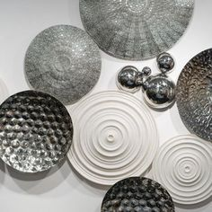 Individual discs from Gold Leaf Design Group. Each piece is sold separately allowing for custom wall installations...