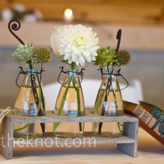 Each centerpiece was different from the next, including candles, milk-jug vases and random objects the couple had collected.