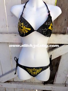 Black bikini splatter triforce eagle Legend of Zelda swimsuit top and bottom. $50.00, via Etsy.