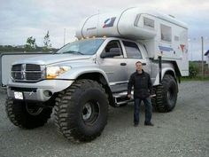 Dodge truck with big tires and motor home