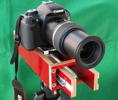 DIY Slide Focus Rail.   Side view, camera and macro lens attached, moving section protruding through forward end plate.
