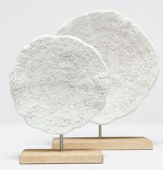 Eye Catching art, Beautifully crafted, Impactful design  The Krysta Sculpture by Made Goods is a dimensional faux mushroom coral on banana leaf stand.  Smart when displayed in a built-in, bookcase or on a console.  The Krysta Set of 2 add a fresh detail to any space. FREE SHIPPING. $750