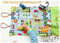 Das E-book ist eine genaue, bebilderte Nähanleitung und enthält Tipps und Tricks, wie du ganz allein diese tolle Spielzeugtasche anfertigen kannst für Matchbox-Autos oder Tiere oder sonstiges...