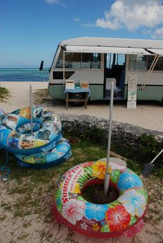 Okinawa, Japan. Perhaps they're hiring out the funky floating rings? It does seem to be a shop of sorts...