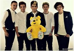One Direction with a teddy bear