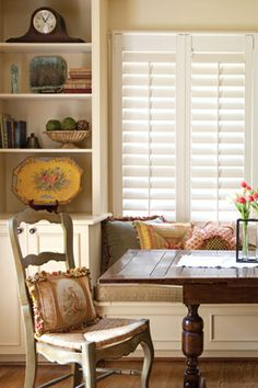 Built-in shelves and cabinets on either side of a window seat give added display and storage to this space.