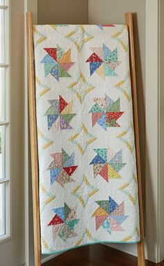 "Spinning Pinwheels Quilt Kit: Use paper foundation piecing to make this pretty pinwheel quilt featuring 1930s prints. The quilt measures 48"" x 60"" and was designed by Nancy Mahoney."