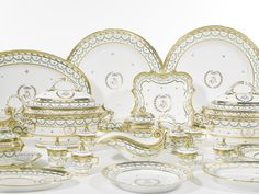 An extensive Paris (duc d'Angouleme) dinner service, Paris,, circa 1790  dceorated in green and gilt with garlands and monogram VB within laurel wreath, iron-red stencilled mark, comprising: 5 tureens and covers, 104 dinner plates, 26 soup plates, 2 sauce tureens on stands and covers, 4 sauce boats on stands, 4 salad bowls in ...Quantity: 212                                                                     ...