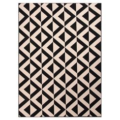 Stylishly anchor your living room seating group or patio ensemble with this Turkish-made indoor/outdoor rug, showcasing 2-tone geometric motif. ...