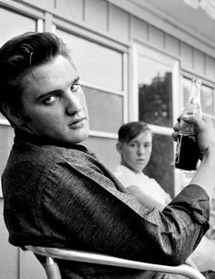Elvis Presley sitting on the porch of his home in Memphis, July 4 1956.