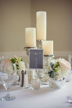 Centerpiece of mercury glass with peonies and garden roses | Kensey + John | Haig Point Wedding | #HiltonHead #DestinationWedding