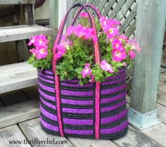 How to Make a Tote Bag Planter / www.thriftyrebel.com... this is a $1.00 thrift store find. she has other cute purse finds turned into planters at the site!