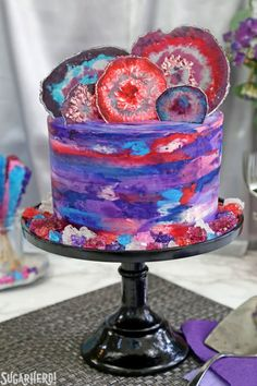 Agate Cake - with gorgeous, EDIBLE candy agate slices, and a pretty watercolor buttercream effect! | From SugarHero.com