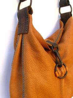 Cibado Bag details - hand sewn with the cross stich on the gussets. Closure is of vintage horse tack hardware.