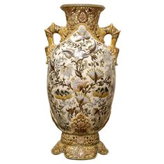 Monumental Zsolnay Porcelain Vase  Hungary  circa 1880  A fine and rare monumental Zsolnay porcelain vase, circa 1880. The vase has a flared neck with an openwork floral field. The main body just below with a cream colored ground is painted with floral blossoms and vines. The large body is supported on a petaled base. The underside with impressed and underglaze Zsolany factory marks.