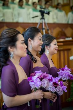 shades of purple flowers for these beautiful bridesmaids including the treasure of the orchid family...cattleya orchids.