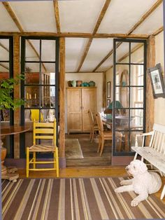 My dream house would have lots of these things. Vestibule, landing stairs, transoms, sleeping porch, etc. House Columns, Staircase Landing, Sleeping Porch, Separating Rooms, Vestibule, Cozy Room, Home Trends, Built Ins, Architecture Details