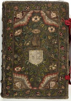 17th century embroidered Canvas book, pictorial angel and floral motif  with two red ribbons. by Aria Nadii, via Flickr