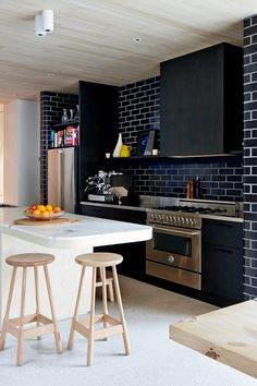Charcoal glazed bricks in kitchen. Photo - Sean Fennessy, production – Lucy Feagins / The Design Files.