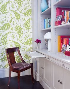 Get some interior decoration inspiration from this beautiful writing desk area that features a glorious display of plant wallpaper featuring green leaves and flowers that can be used in home design for a splash of green or a botanical accent. Use plants in your home interior design!