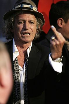 Fuck You - Keith Richards   of the Rolling Stones gives the middle finger to photographers in NYC.