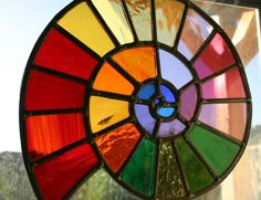 Rainbow stained glass window : Note how the colors start warm then spiral in to a cold core. Stained Glass Designs, Stained Glass Panels, Stained Glass Projects, Stained Glass Patterns, Stained Glass Art, Mosaic Glass, Fused Glass, Stained Glass Suncatchers, Colored Glass