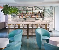 Soft blue and shiny gold at the Avalon Hotel, Beverly Hills. Design and photo by Kelly Wearstler