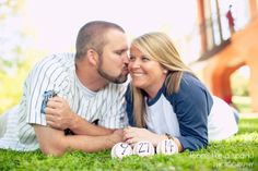 baseball theme, ballpark, kisses, romance, engagement photos, engaged, atlanta photographer :: Emily + Steve's Engagement Shoot at Piedmont Park in Atlanta, GA :: with Alyssa