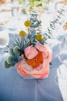 Bright desert wedding centerpiece with cactus and billy balls
