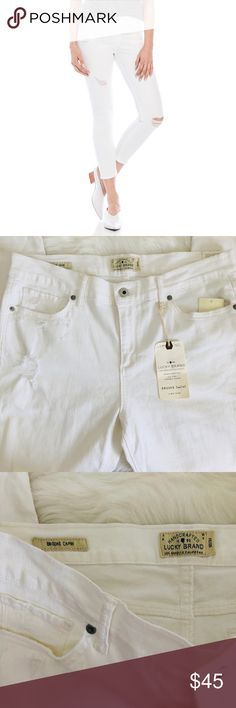 Lucky Brand White Brooke Capri Distressed Jeans New with tags. Distressing around the knee area. Waist measures 17.5 inches. Inseam is 27 inches. Has some markings on the back pictured. Lucky Brand Jeans Ankle & Cropped