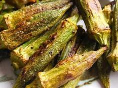 "Roasted Okra with olive oil and sea salt! Tons of fresh okra at the market here in Charleston. Baking it, dries the okra ""slime"" a bit and makes it sweeter. Like candy . Side Dish Recipes, Vegetable Recipes, Vegetarian Recipes, Cooking Recipes, Healthy Recipes, Vegetarian Barbecue, Barbecue Recipes, Oven Recipes, Vegetarian Cooking"