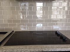 would use grey grout.  Grey Glass Subway Tile Backsplash For Kitchen And Electric Stove Top ...