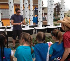 Doug teaches a local Girl Scouts troop about aeroponics. (Photo credit: VertiFarms)