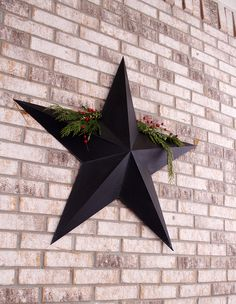 christmas porch decoration.  Use a primitive metal star & hang holly or pine on it!