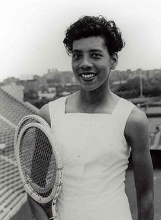 Althea Gibson, standing in Forest Hills Stadium, broke the color barrier at Forest Hills in 1950 by gaining entry into US Championships. Gibson, Wimbledon & US National Singles Champion, was inducted into Tennis Hall of Fame in Women In History, Black History, Althea Gibson, Us Championship, Vintage Tennis, Sport Icon, Star Wars, Sports Pictures, African American History
