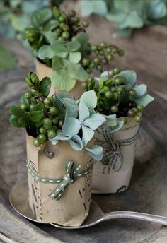 Elderberries and green hydrangea in little sheet music paper cups