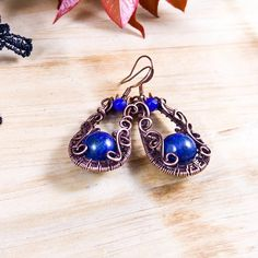 Handmade vintage earrings; wire wrapped copper earrings with lapis lazuli gemstone; oxidized antiqued copper wire and natural gemstone jewelry 1 7/8 ( with a hook ) X 3/4 ( 4.8 X 1.9 cm ) Beautiful lapis lazuli gemstone captured in hand woven antiqued oxidized copper wire. Victorian inspired.  Matching necklace: https://www.etsy.com/listing/500551004  Lapis lazuli is a stone of truth, inner power and organization. It also is said to enhance creativity and increas...