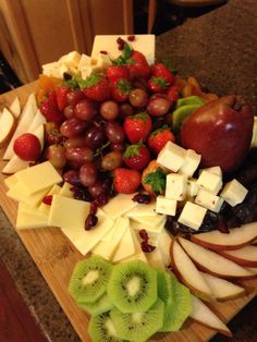 Holiday fruit and cheese platter. Fun to put together with a variety of fresh and dried fruit that creates a really colorful and tasty presentation!
